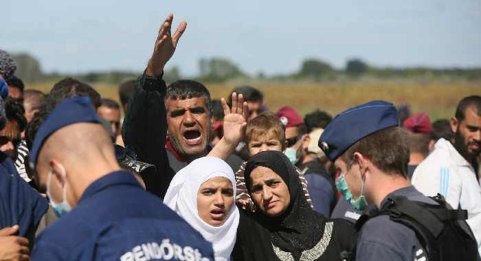 Hungarian police and migrants at the border town of Roszke, Hungary, September 7, 2015. Paul Hackett/In Pictures/Corbis