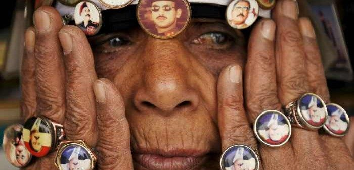 A woman with pins showing pictures of former President Saleh and his son at a rally against airstrikes, Sanaa, April 3, 2015. Mohamed Al-Sayaghi/Reuters/Corbis