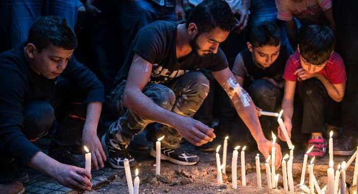 A candle vigil for victims of the previous day's twin bombings, southern Beirut, November 13, 2015. Eduardo Lima/Demotix/Corbis