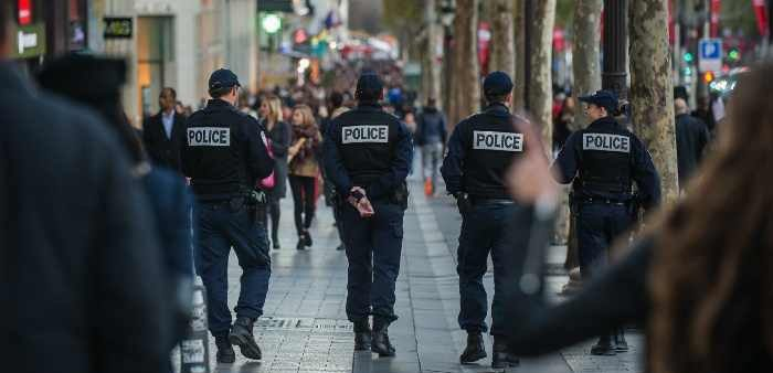 French police patrol the Champs Elysees, Paris, November 15, 2015