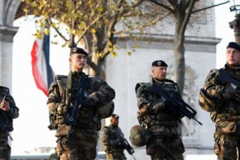 French soldiers patrol in front of the Arc de Triomphe, Paris