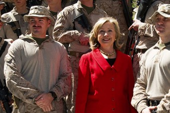 Then-Secretary of State Hillary Clinton poses with U.S. Marines at the American Embassy, Cairo, March 16, 2011. Paul J. Richards/Pool/Reuters