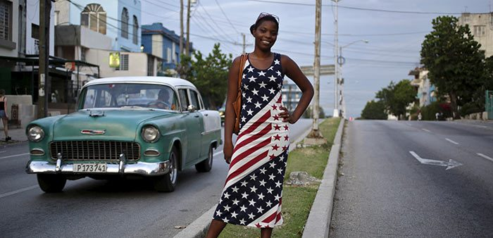 Cuban woman poses wearing an American flag dress, Havana, Aug. 4, 2015. Enrique de la Osa/Reuters/Corbis