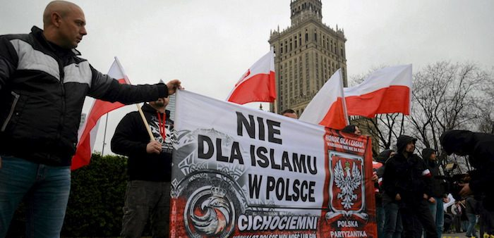 "Far-right protesters carry banner reading ""No Islam in Poland"""