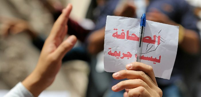 Journalist holding a sign, ''Journalism is not a crime'', during a protest at the Press Syndicate in Cairo, May 4, 2016. Reuters/Staff