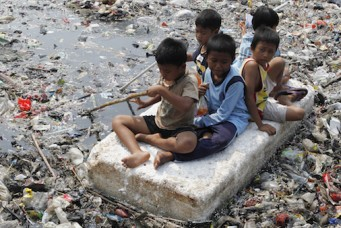 Children playing in a polluted river, Jakarta, Sept. 19, 2012. Enny Nuraheni/Reuters