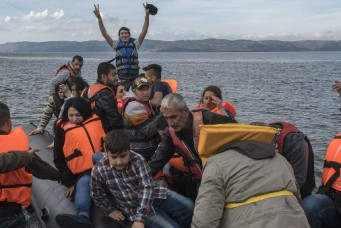 A boat carrying Syrian refugees lands at Lesbos island, Greece, October 29, 2015.