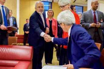 Iranian Foreign Minister Javid Zarif shakes hands with U.S. Secretary of State John Kerry, Vienna, July 14, 2015. U.S. Department of State