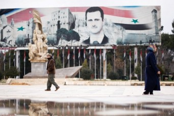 A billboard depicting Syria's President Bashar Al-Assad in the government controlled area of Aleppo, Syria, Dec. 17, 2016. Omar Sanadiki/Reuters