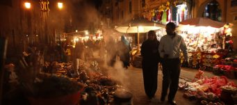 A couple strolls through a market, Cairo, Dec. 15, 2012. Khaled Abdullah/ Reuters