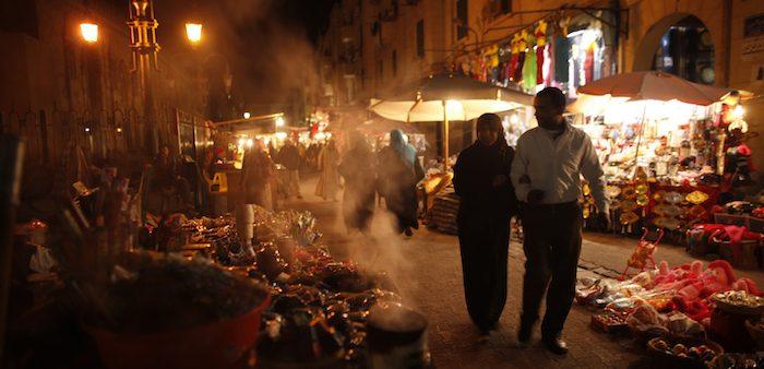 A couple strolls through a market, Cairo, Dec. 15, 2012. Khaled Abdullah/ Reuters