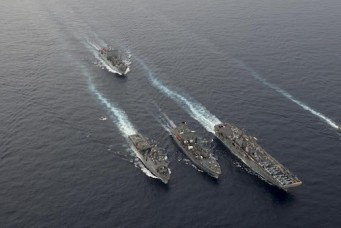U.S. Navy ships steaming in formation during a drill in the South China Sea, Oct. 13, 2016. Will Gaskill/United States Navy