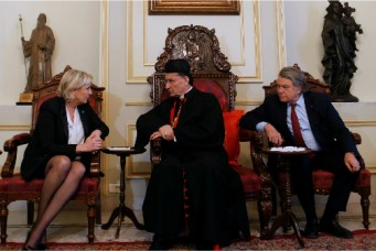 Marine Le Pen, France's National Front (FN) leader and candidate for the 2017 presidential elections, with Cardinal Bechara Boutros Rai of Lebanon, the Maronite Patriarch of Antioch and the Whole Levant, and French deputy Gilbert Collard in Bkerke, north of Beirut, Feb. 21, 2017. Mohamed Azakir/Reuters