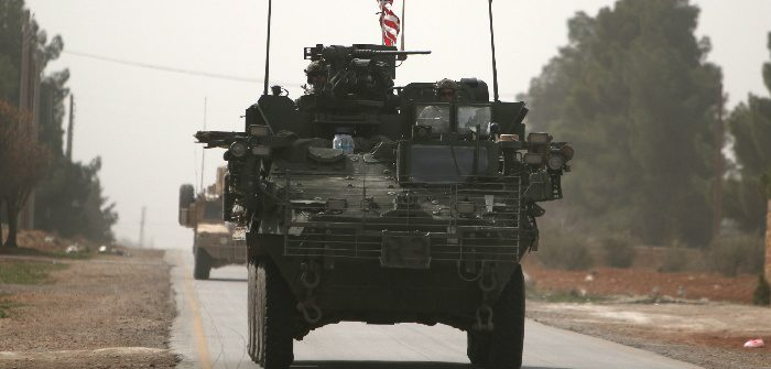 American army vehicles drive north of Manbij, in Aleppo Governorate, Syria. Rodi Said/Reuters