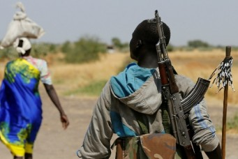 An armed man close to the village of Nialdhiu, South Sudan, Feb. 7, 2017. Siegfried Modola/Reuters