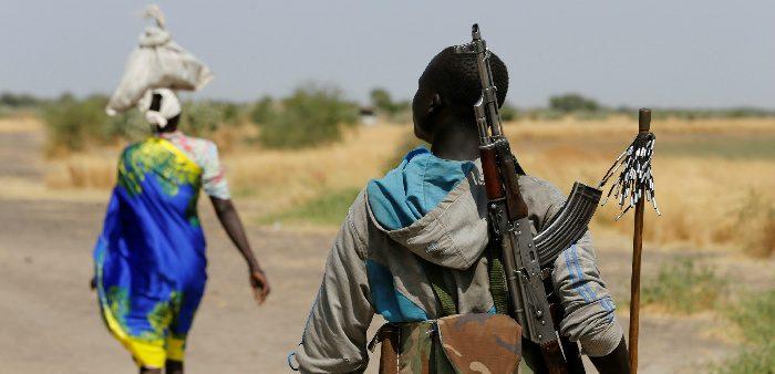 An armed man close to the village of Nialdhiu, South Sudan, Feb. 7, 2017. Siegfried Modola/Reuters