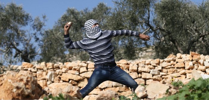 Palestinian protester during clashes with Israeli troops in West Bank, Kofr Qadom, Feb. 10, 2017. Mohamad Torokman/Reuters