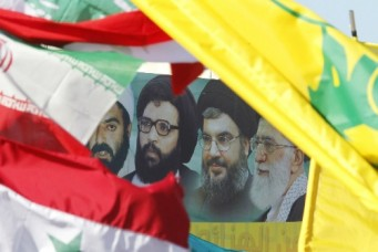 A poster of Iran's Supreme Leader Ayatollah Ali Khamenei, Hezbollah Secretary-General Sayyed Hassan Nasrallah, former Hezbollah Secretary-General Sayyed Abbas Al-Musawi and Lebanese resistance leader and cleric Sheikh Ragheb Harb, in Bint Jbeil, Lebanon, May 25, 2014. Ali Hashisho/Reuters