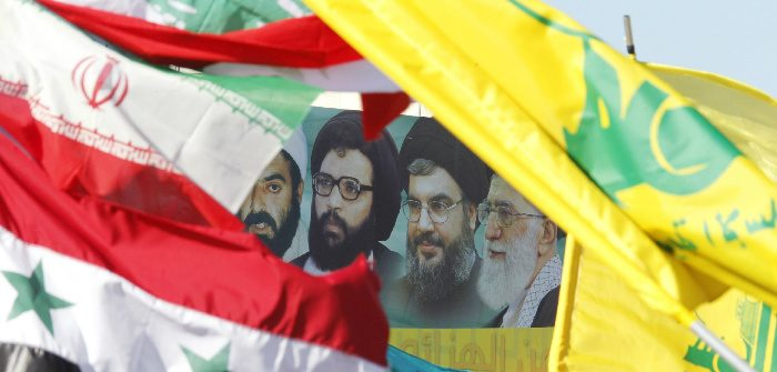 A poster of Iran's Supreme Leader Ayatollah Ali Khamenei, Hezbollah Secretary-General Sayyed Hassan Nasrallah, former Hezbollah Secretary-General Sayyed Abbas Al-Musawi and Lebanese resistance leader and cleric Sheikh Ragheb Harb, in Bint Jbeil, Lebanon, May 25, 2014. Ali Hashisho/Reuters