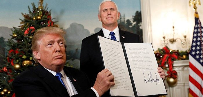 U.S. President Donald Trump holds up the proclamation that the United States recognizes Jerusalem as the capital of Israel and will move its embassy there, during an address from the White House in Washington DC, Dec 6, 2017. Kevin Lamarque/Reuters