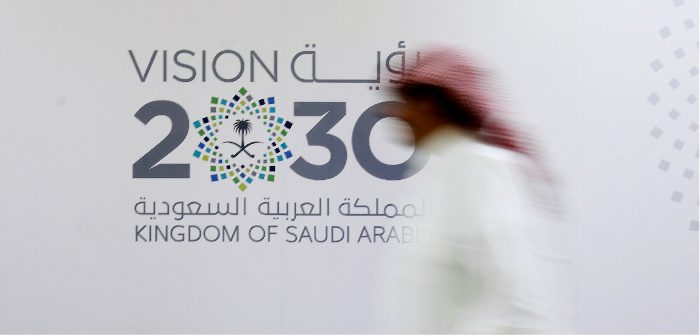 A new kingdom of saud the cairo review of global affairs a man walks past the logo of the vision 2030 jeddah saudi arabia june 7 2016 faisal al nasserreuters malvernweather Choice Image