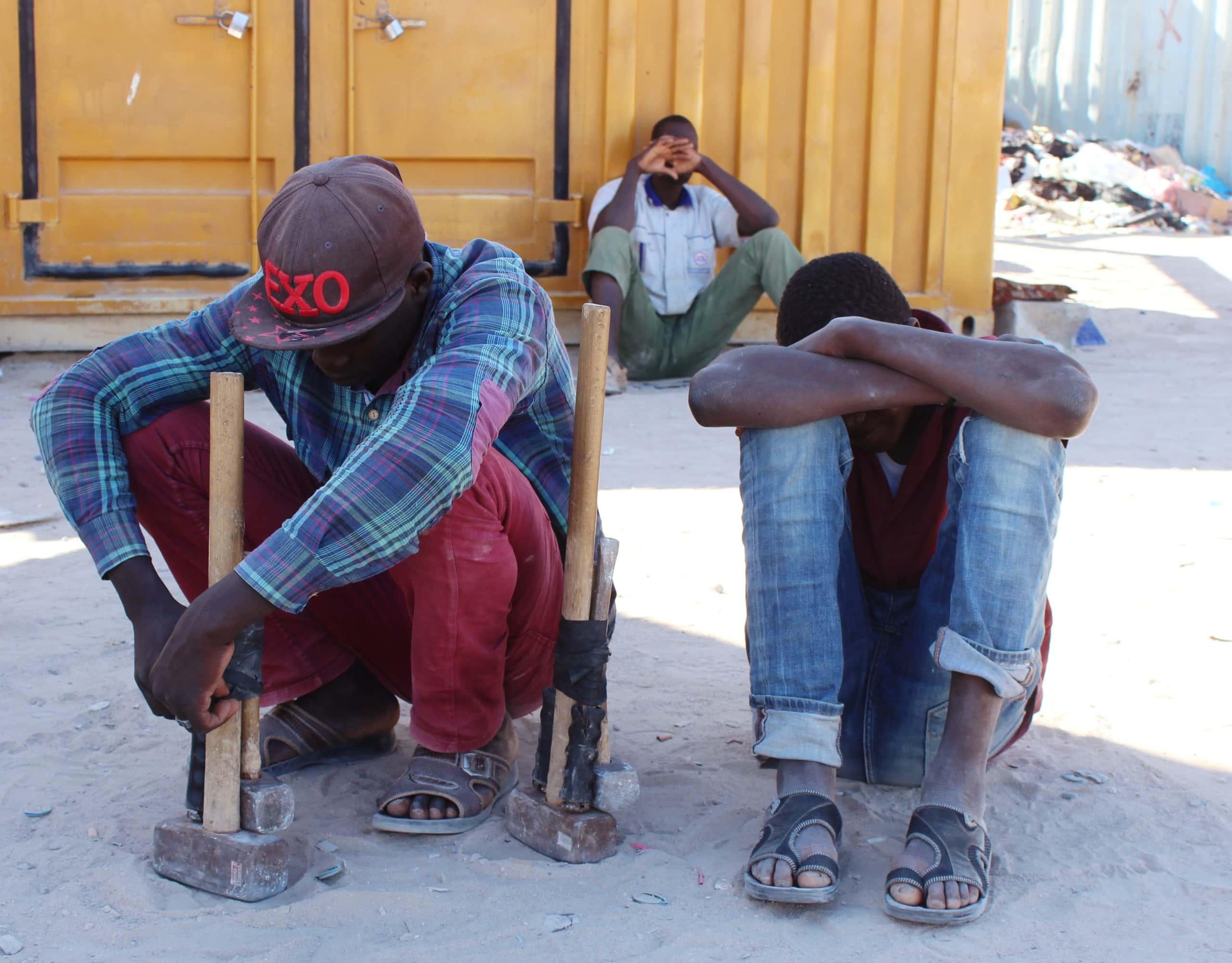 migrants in libya coronavirus scaled.'